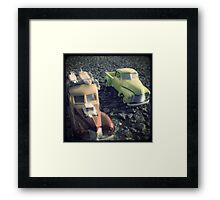 two matchbox trucks on the road Framed Print
