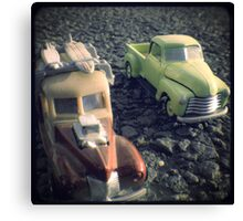 two matchbox trucks on the road Canvas Print