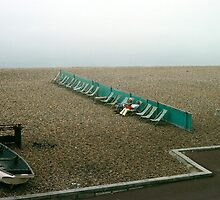 Brighton beach on a cold day in May, UK, 1980s. by David A. L. Davies