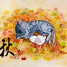 Kitty cat taking a nap with a bunny rabit on autum leaves by meomeo