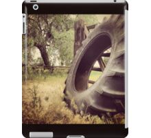 Tractor Tire Under Some Willow Trees iPad Case/Skin