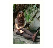 young lady sit down in park Art Print