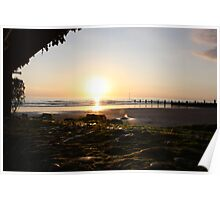 Sunset looking through wooden posts on Tywyn beach Poster