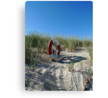 Lifebuoy In The Dunes Canvas Print