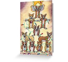 Corgi dogs make up a fur tree for Christmas Greeting Card