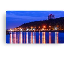 Evening lights above the river Canvas Print
