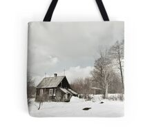 dilapidated wooden house cottage in winter  Tote Bag