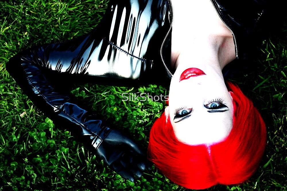 L, high contrast, lying on the grass by SilkShots