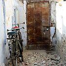Laneway with Bicycles & Steel Door, Gujurat, India by RIYAZ POCKETWALA