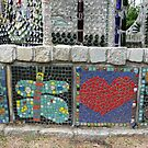 Mosaics at the base of the Minnie Evans Bottle Chapel by nealbarnett