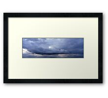 Heavy blue clouds Framed Print