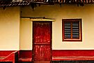 House with red door by Vikram Franklin