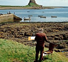 Artist at Lindisfarne (Holy Island), Northumberland, England, UK. by David A. L. Davies