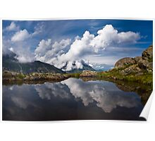 Trolls' clouds reflecting in Norwegian mountain lake. Poster