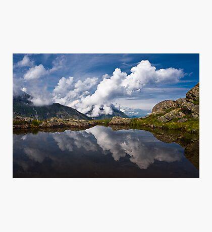 Trolls' clouds reflecting in Norwegian mountain lake. Photographic Print