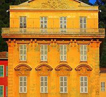 Beautiful ornate yellow building facade in Nice, Cote d'Azur, France by Atanas Bozhikov Nasko