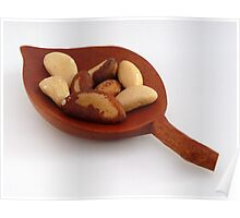 Wooden carved bowl with brazil nuts Poster