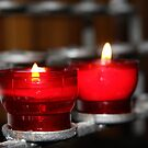 Candles in red holders by Susan Leonard