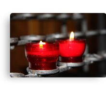 Candles in red holders Canvas Print