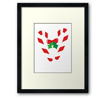 Candy canes candy for Christmas with a bow Framed Print