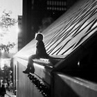 Silhouette of girl sitting by Cami Hagen