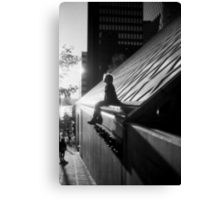 Silhouette of girl sitting Canvas Print