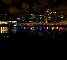 Melbourne lining the Yarra at night - Australia by Claire Haslope