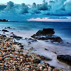 Seascape rocks sea and clouds at sunset - Italy by Francesco Malpensi