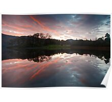 Reflecting on a beautiful sunrise over Derwent water Poster