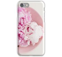 Freshly cut peony blossoms on pink plate iPhone Case/Skin