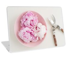 Freshly cut peony blossoms on pink plate Laptop Skin