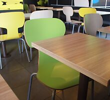 Wooden tables and chairs in a fastfood by vladromensky
