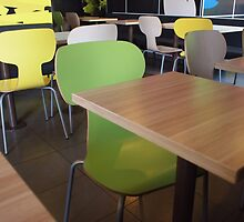 Wooden tables and chairs with furiture in restaurant  by vladromensky