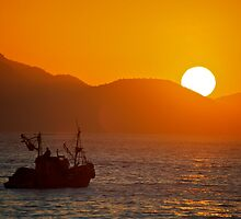 Fishing boat at sunrise by grcav