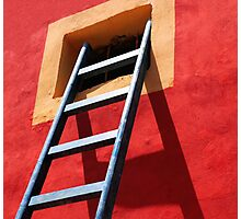 Blue ladder on a red wall Photographic Print