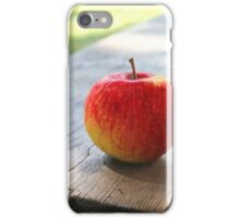 Red apple on a wooden bench iPhone Case/Skin