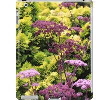 Purple Flowers Against Green Shrubs iPad Case/Skin
