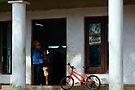 Waiting at the Barbers, Vinales, Cuba by David Carton