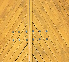 Yellow gate closeup with diagonal wooden strips by vladromensky