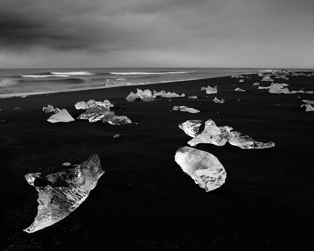 Icy jewels on black beach - Iceland by Kathy White