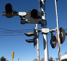 A set of broken red flashing  light's train signal by Eric Sanford