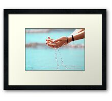 Water through hands Framed Print