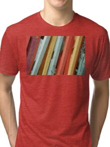 Happy Colorful Chairs Stacked on a Porch Tri-blend T-Shirt