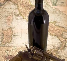 Revolver and wine on map of Italy by opticalreflex