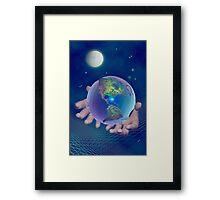 Hands holding the world Framed Print