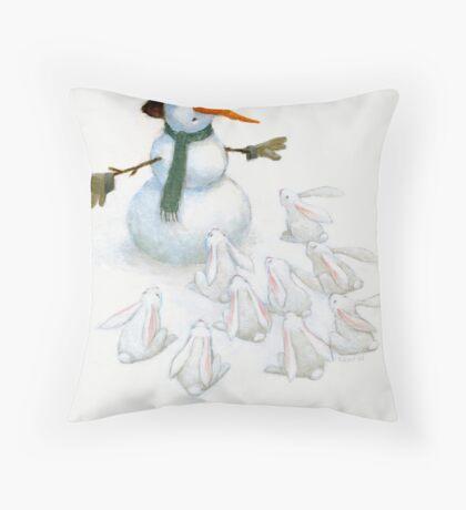 Snowman with Carrot Nose Facing Hungry Bunnies Throw Pillow