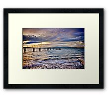 Storm clouds over jetty Framed Print