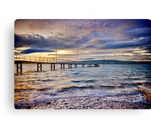Storm clouds over jetty Canvas Print