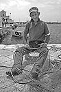 Fisherman Mending Nets - Gallipoli, Italy by Debbie Pinard