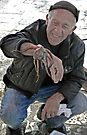 Fisherman with Octopus - Gallipoli, Italy by Debbie Pinard